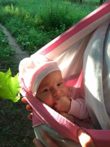 baby in a pink ring sling