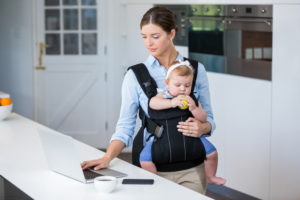 woman with a baby in front-facing baby carrier