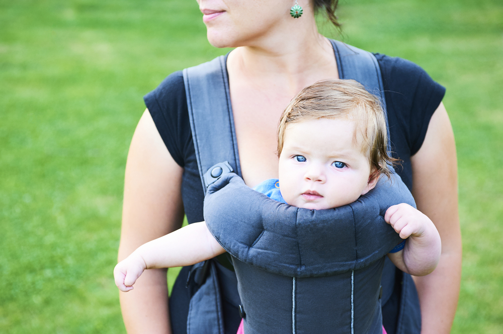 beautiful baby in ergo baby carrier