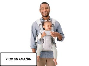 hadsome dad with the child in the baby carrier
