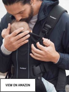 dad with a baby in baby carrier